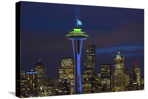 Space Needle with Seahawk colors and 12th man flag. Washington, USA-Jamie & Judy Wild-Stretched Canvas Print