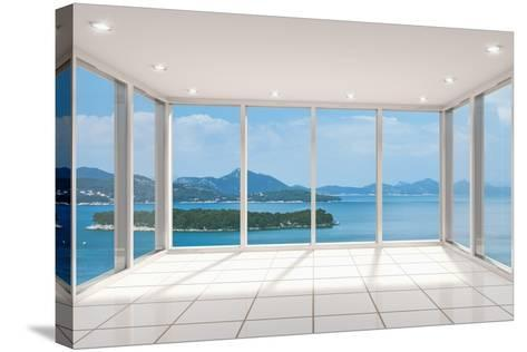 Empty Modern Lounge Area with Large Bay Window and View of Sea-FreshPaint-Stretched Canvas Print