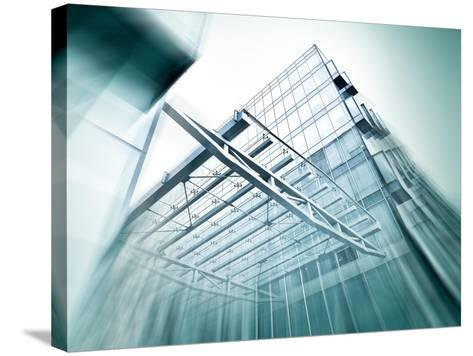 Panoramic and Perspective Wide Angle View to Steel Blue Background of Glass High Rise Building-Vladitto-Stretched Canvas Print