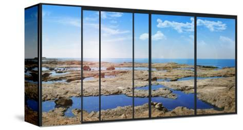 Panoramic Modern Window with a Stones and Sea Landscape- Whiteisthecolor-Stretched Canvas Print