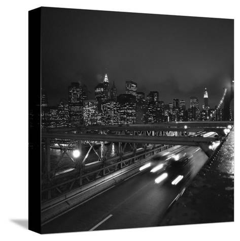 Brooklyn Bridge Traffic with Manhattan View at Night-Henri Silberman-Stretched Canvas Print