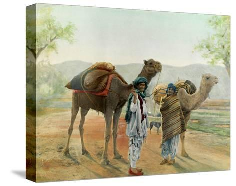 Two Boys Walk with their Arabian Camels Down a Dirt Road--Stretched Canvas Print