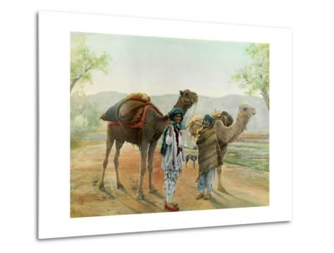 Two Boys Walk with their Arabian Camels Down a Dirt Road--Metal Print