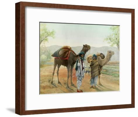 Two Boys Walk with their Arabian Camels Down a Dirt Road--Framed Art Print