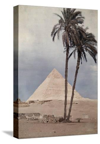 Palm Trees Stands in the Foreground of One of the Pyramids of Giza-Gervais Courtellemont-Stretched Canvas Print