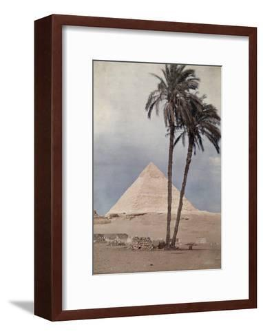 Palm Trees Stands in the Foreground of One of the Pyramids of Giza-Gervais Courtellemont-Framed Art Print