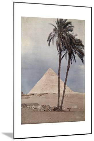 Palm Trees Stands in the Foreground of One of the Pyramids of Giza-Gervais Courtellemont-Mounted Photographic Print
