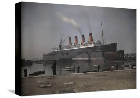 """A View of the Cunard S.S. """"Mauretania"""" at Dock-Clifton R^ Adams-Stretched Canvas Print"""