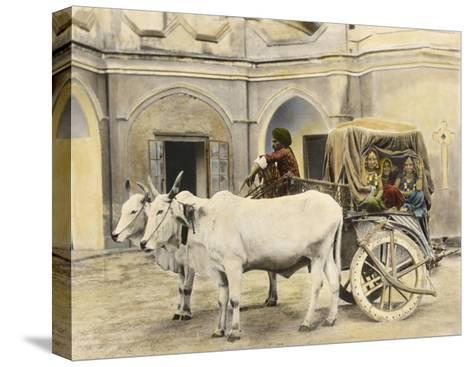 Teenage Girls Smile and Wave Out of a Canopied Wagon Drawn by Oxen-Franklin Price Knott-Stretched Canvas Print