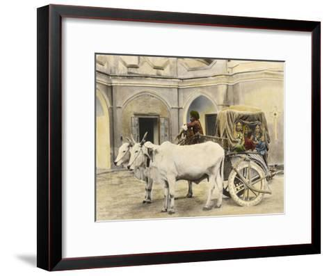 Teenage Girls Smile and Wave Out of a Canopied Wagon Drawn by Oxen-Franklin Price Knott-Framed Art Print