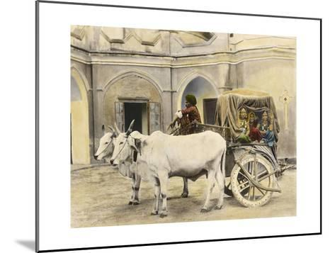 Teenage Girls Smile and Wave Out of a Canopied Wagon Drawn by Oxen-Franklin Price Knott-Mounted Photographic Print
