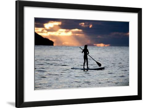 A Young Girl on a Stand Up Paddle Board on Baleia Beach at Sunset-Alex Saberi-Framed Art Print