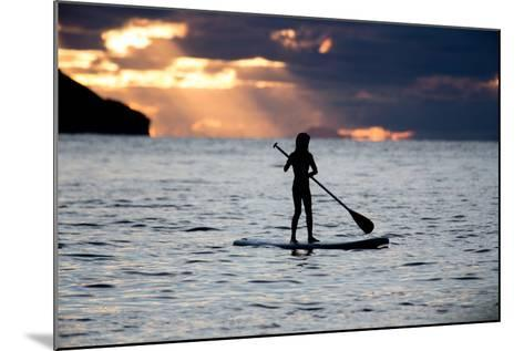 A Young Girl on a Stand Up Paddle Board on Baleia Beach at Sunset-Alex Saberi-Mounted Photographic Print