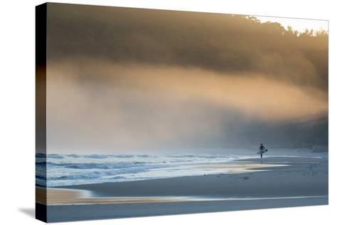 A Surfer on Juquehy Beach at Sunrise-Alex Saberi-Stretched Canvas Print