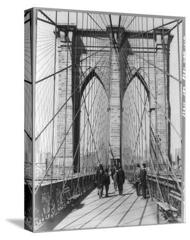 A Photograph of People Standing and Walking on the Brooklyn Bridge Promenade--Stretched Canvas Print