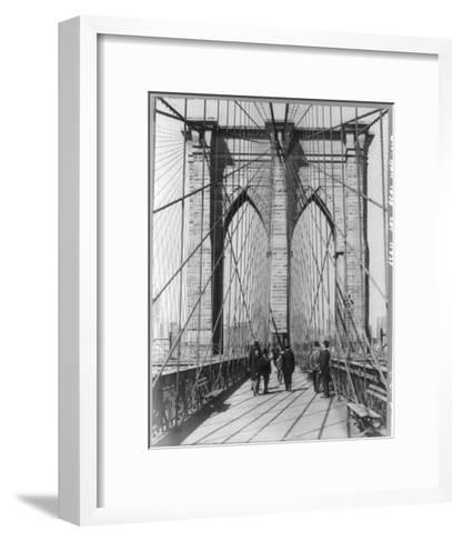 A Photograph of People Standing and Walking on the Brooklyn Bridge Promenade--Framed Art Print