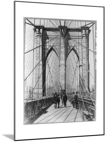 A Photograph of People Standing and Walking on the Brooklyn Bridge Promenade--Mounted Photographic Print