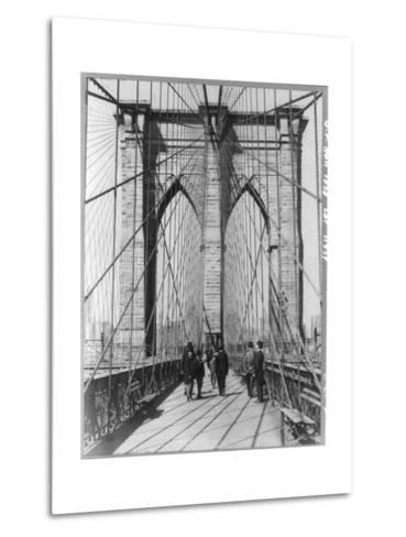 A Photograph of People Standing and Walking on the Brooklyn Bridge Promenade--Metal Print