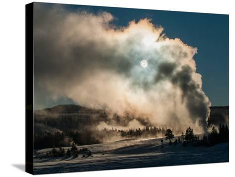 Vapor from Old Faithful Rises More Than Two Hundred Feet to Partially Obscure the Sun-Tom Murphy-Stretched Canvas Print