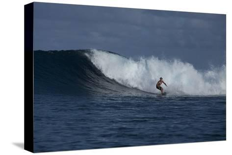 Surfing a Wave Off Tahiti Island-Andy Bardon-Stretched Canvas Print