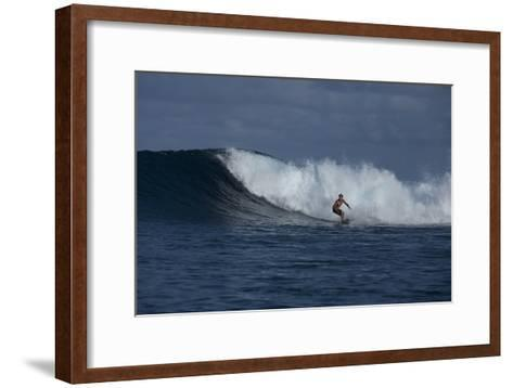 Surfing a Wave Off Tahiti Island-Andy Bardon-Framed Art Print