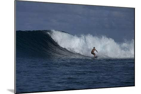 Surfing a Wave Off Tahiti Island-Andy Bardon-Mounted Photographic Print