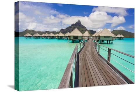 The Boardwalk to the Over-Water Bungalows at the Le Meridien Resort-Mike Theiss-Stretched Canvas Print