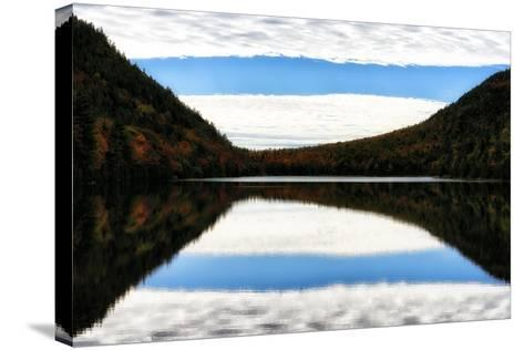 Clouds and Forests in Autumn Colors Reflected in the Calm Surface of a Lake-Robbie George-Stretched Canvas Print
