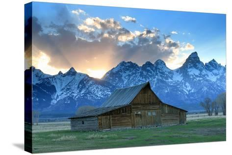 At Sunset, the Teton Range Rises Behind a Historic Barn on Mormon Row-Robbie George-Stretched Canvas Print