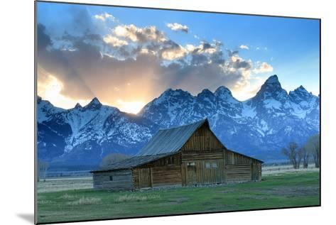 At Sunset, the Teton Range Rises Behind a Historic Barn on Mormon Row-Robbie George-Mounted Photographic Print