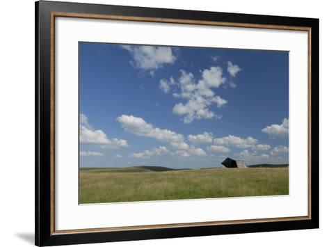 An Abandoned Barn in a Vast Field under a Sky with Puffy Clouds-Michael Forsberg-Framed Art Print