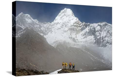 A Climbing Team Stand Looking Up at Ama Dablam in the Everest Region of Nepal-Alex Treadway-Stretched Canvas Print