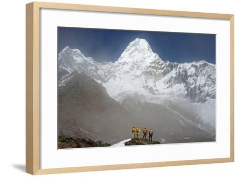 A Climbing Team Stand Looking Up at Ama Dablam in the Everest Region of Nepal-Alex Treadway-Framed Art Print