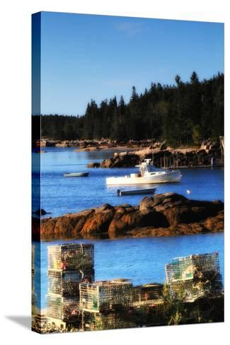 Lobster Traps Stacked on Shore, with Lobster and Row Boats Anchored Offshore-Robbie George-Stretched Canvas Print