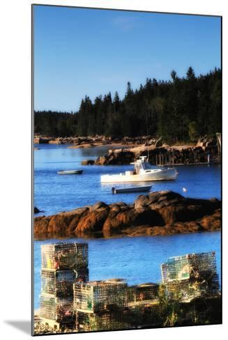 Lobster Traps Stacked on Shore, with Lobster and Row Boats Anchored Offshore-Robbie George-Mounted Photographic Print