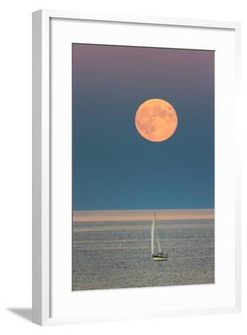 The Harvest Moon Rises over a Sailboat in Casco Bay-Robbie George-Framed Art Print