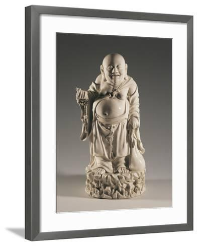 Budai, also Called the Smiling Buddha, on Rocks with a Sack and a Buddhist Rosary--Framed Art Print