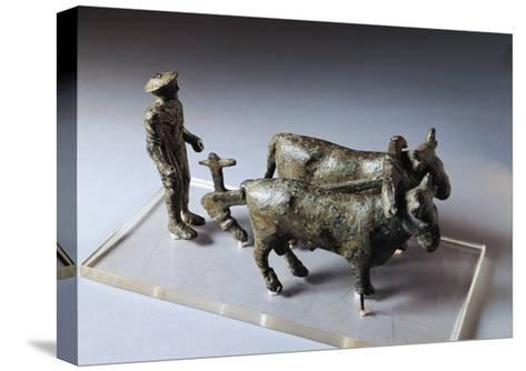 Italy, Arezzo Province, Bronze Statuette of Ploughman with Oxen--Stretched Canvas Print