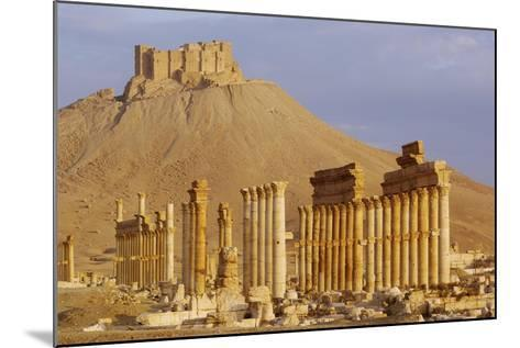 Syria, Palmyra, Column Ruins with Qalaat Ibn Maan Castle in Background--Mounted Giclee Print