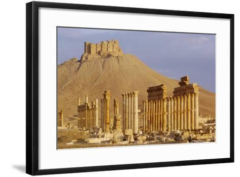 Syria, Palmyra, Column Ruins with Qalaat Ibn Maan Castle in Background--Framed Art Print