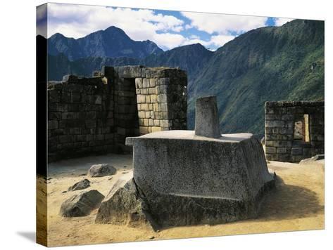 Peru, Urubamba Valley, Inca Civilization, Machu Picchu, Intihuatana Stone or Solar Calendar--Stretched Canvas Print