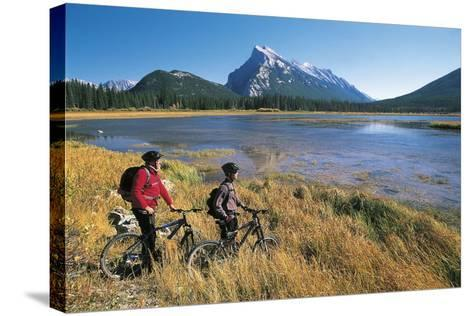 Canada, Alberta, Banff National Park, Vermilion Lake, Tourists with Bikes--Stretched Canvas Print