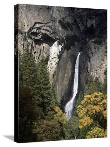 USA, California, Yosemite National Park, Waterfall in Yosemite Valley--Stretched Canvas Print