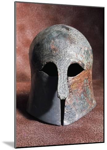 Apulian-Corinthian Bronze Helmet from Serra Lustrante, Armento, Basilicata, Italy--Mounted Giclee Print