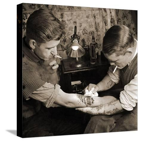 Vintage Shot of a Man Being Tattooed--Stretched Canvas Print