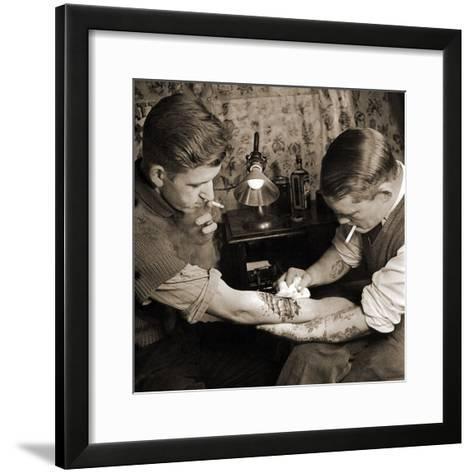 Vintage Shot of a Man Being Tattooed--Framed Art Print