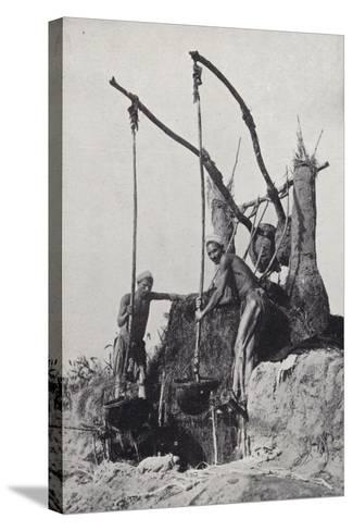 Men Bringing Up Water from the Bottom of a Well--Stretched Canvas Print