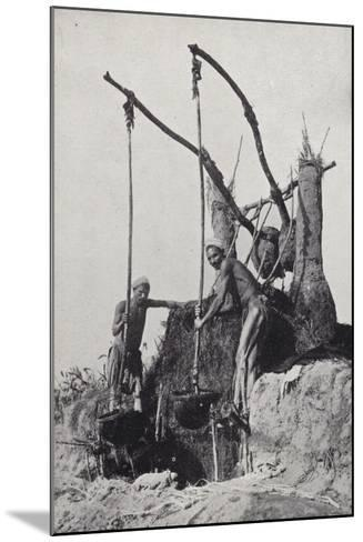 Men Bringing Up Water from the Bottom of a Well--Mounted Photographic Print