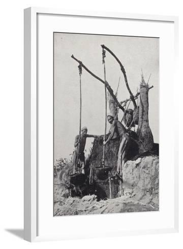 Men Bringing Up Water from the Bottom of a Well--Framed Art Print