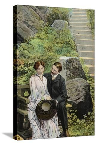 Couple Seated on a Stone Bench Near Some Steps--Stretched Canvas Print